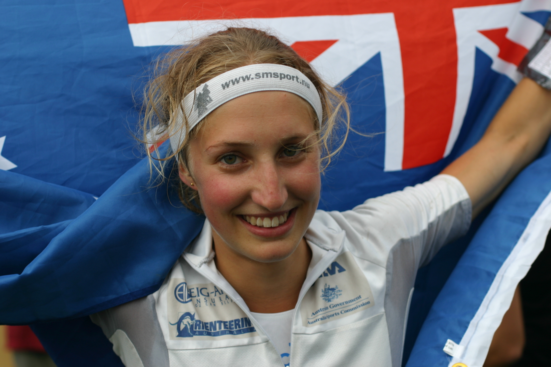 Hanny Allston with the Australian Flag after winning the World Orienteering Champs