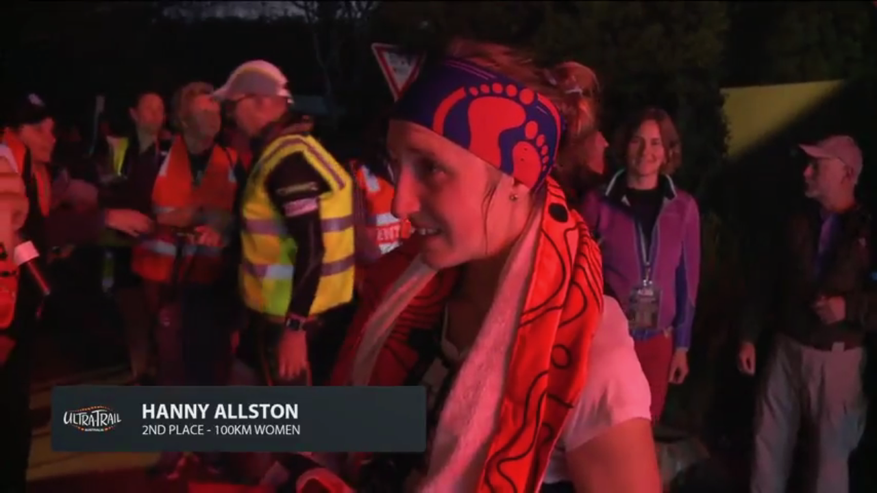 Hanny Allston crossing the finish line at Ultra Trail Australia 100km Race in 2017