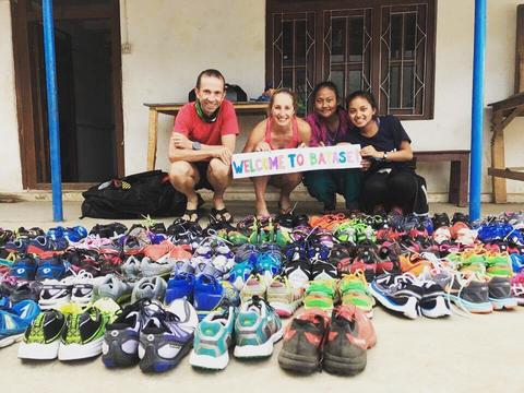 Find Your Feet distributing trail running shoes to the children of Batase